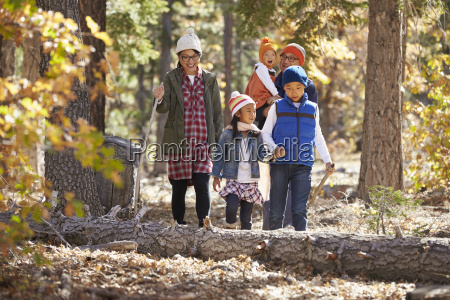 asian family of five enjoying a