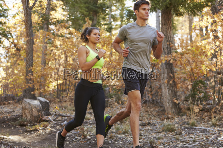 caucasian woman and man running on