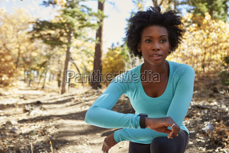young black woman in a forest