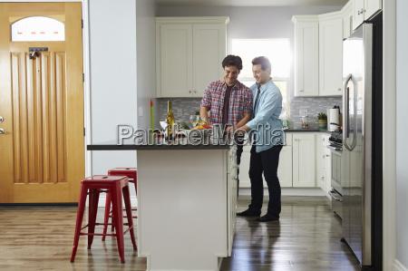 male couple in the kitchen preparing