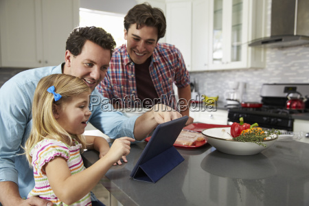 girl using tablet in kitchen with