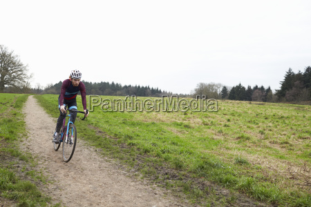 cross country cyclist riding down a