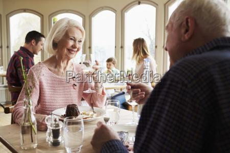 senior couple enjoying dessert in restaurant