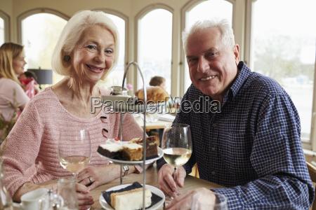 senior couple enjoying afternoon tea in