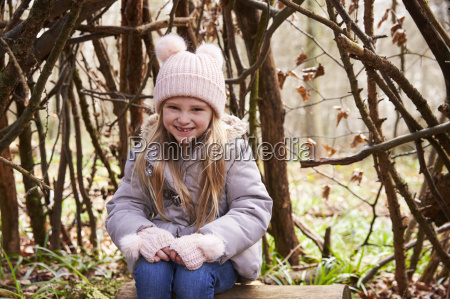 young girl sitting under a shelter