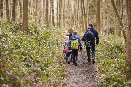 family walking through a wood back