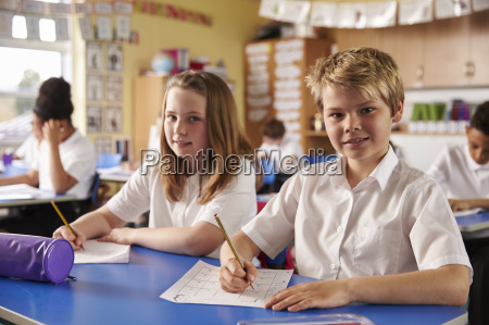 two kids in a lesson at
