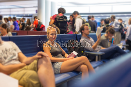 female backpacker waiting at airpot departure