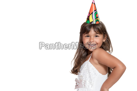 smiling little girl with paper hat