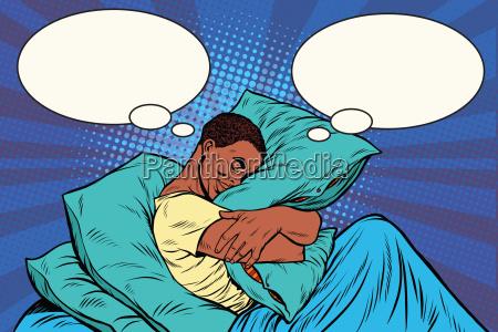 dreamer man in bed hugging a