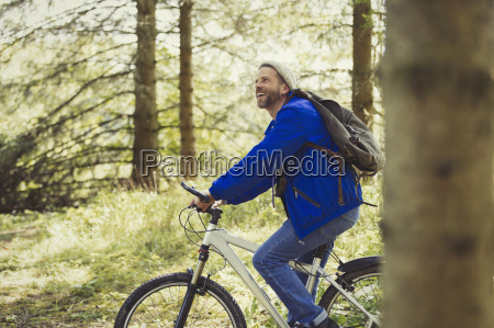 smiling man riding mountain biking in