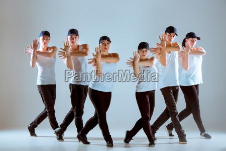 group of men and women dancing