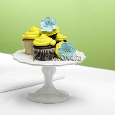 chocolate and vanilla cupcakes with yellow