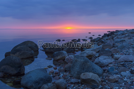 stony beach at sunset fyns hoved