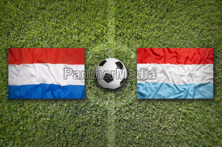 netherlands vs luxembourg flags on soccer