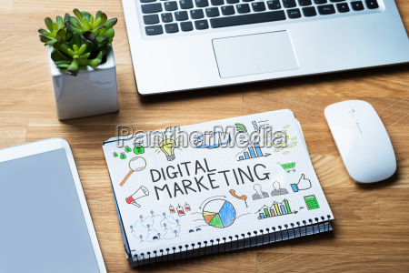 notepad showing digital marketing diagram on