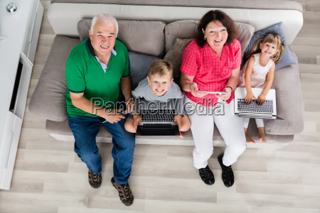 family with their laptop and digital