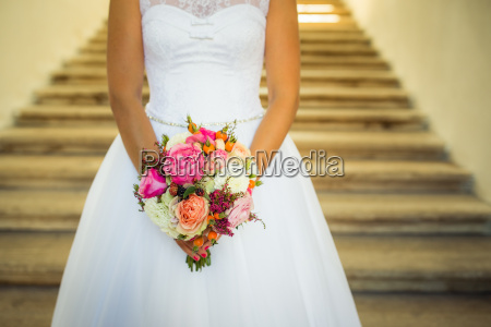lovely wedding bouquet in brides hands