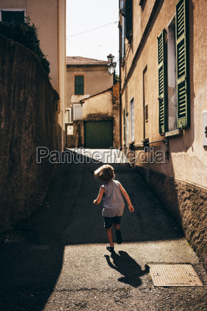 rear view of boy running up