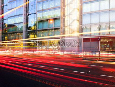 traffic light trails and office building