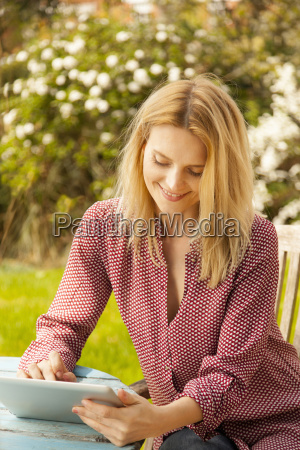 mid adult woman at garden table