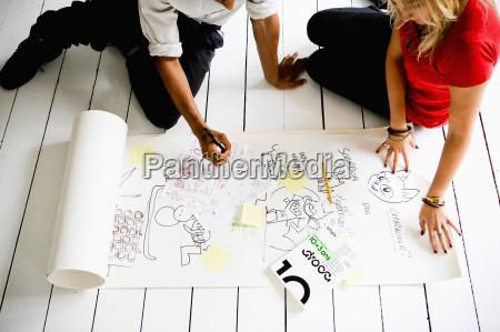 graphic designers brainstorming on floor