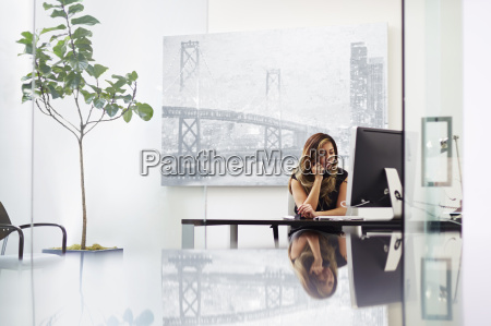 young woman on telephone in office