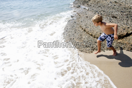 boy playing on beach laguna beach