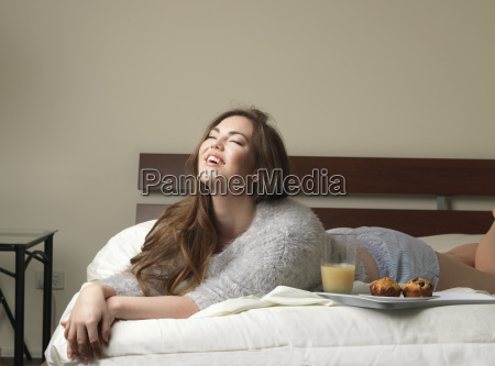 beautiful young woman laughing on hotel