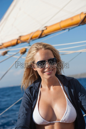 woman smiling on a sailing boat