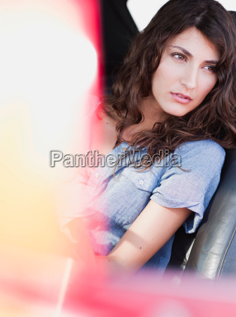 woman sitting in front seat of