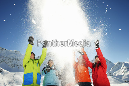 friends throwing snow mid air kuhtai