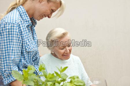 senior woman and granddaughter chatting at