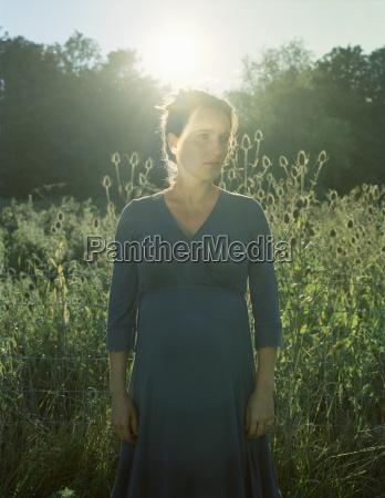 backlit portrait of mid adult woman