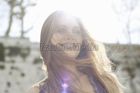 happy young woman in sunlight hair
