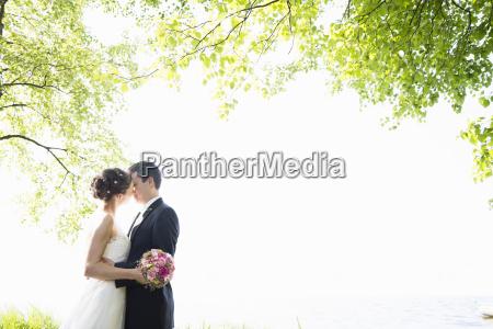 romantic newlywed mid adult couple kissing