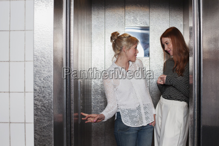 young women in lift