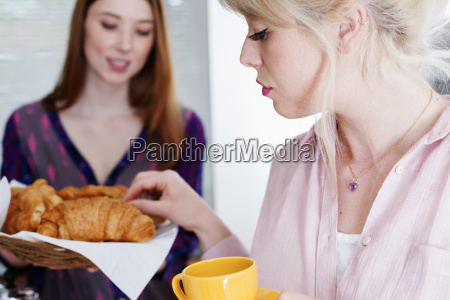 young women with croissants