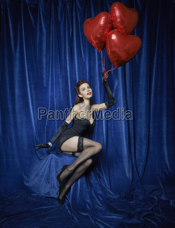 burlesque dancer holding red heart shaped