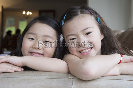portrait of two young girls leaning