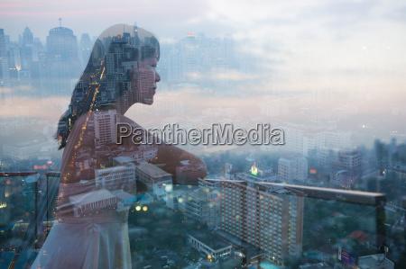 woman on balcony bangkok thailand
