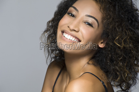 studio portrait of beautiful happy young