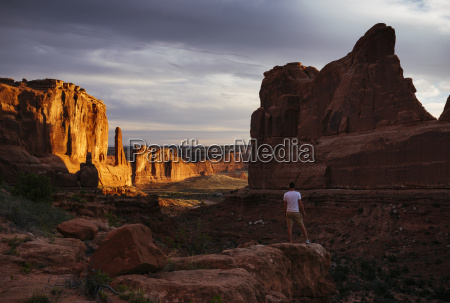 man standing in park avenue at
