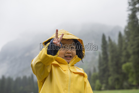 portrait of female toddler wearing yellow