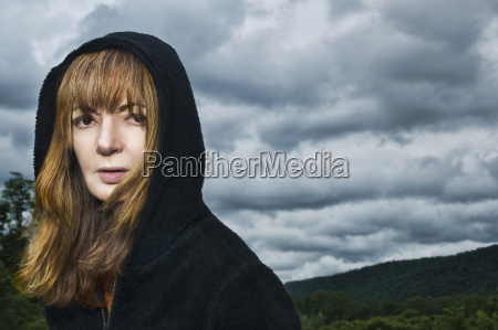 portrait of mature woman wearing hooded