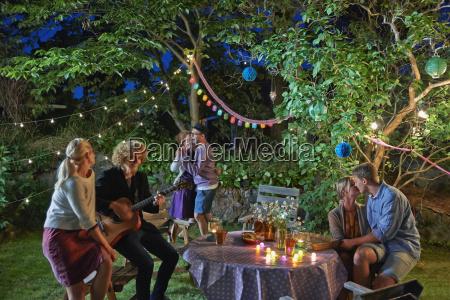 three couples having fun at garden
