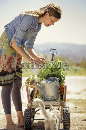 young woman with farm produce on