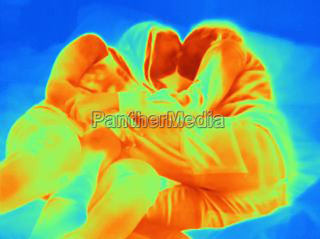 thermal image of young couple kissing