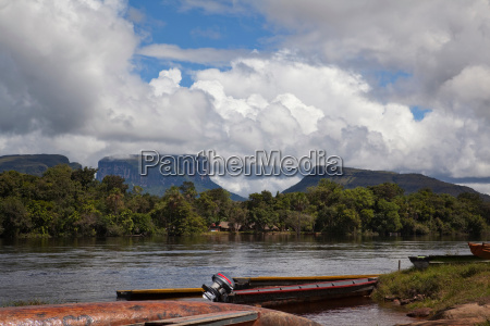 dugout canoes moored on the canaima