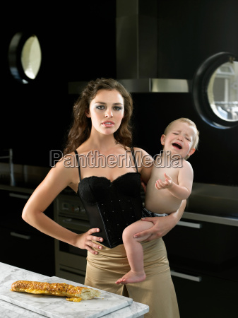 sexy mother holding crying baby boy
